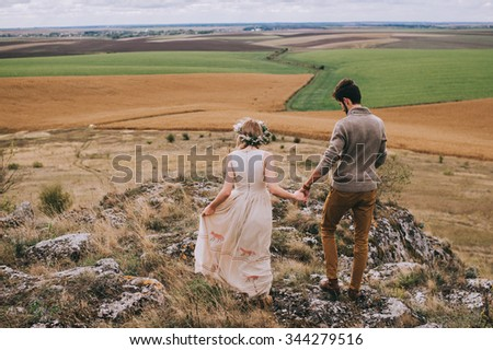 couple in the field near the mountains