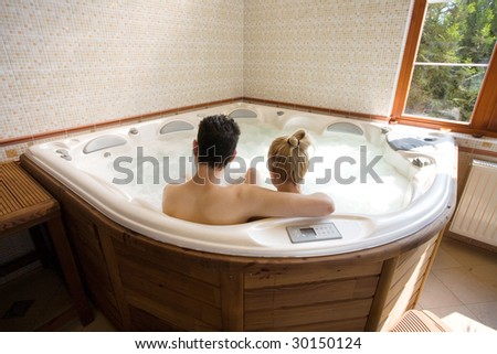 couple in the jacuzzi - stock photo