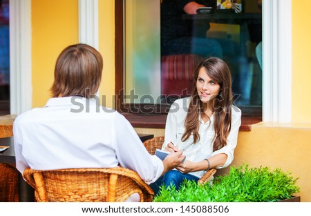 couple in the outdoor cafe - stock photo