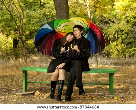 Couple in the park in fall. - stock photo