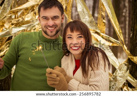 couple in the park in winter - stock photo