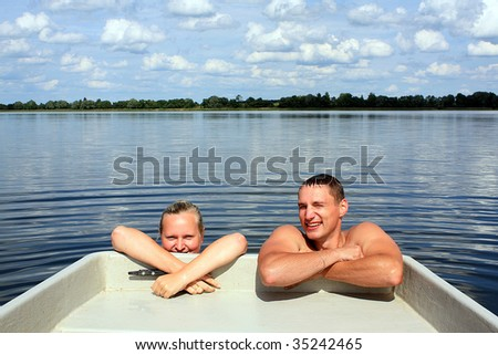 Couple in the water - stock photo