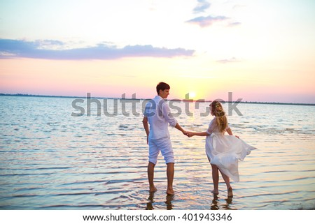 Couple in the water and sunset