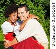 Couple in traditional Bavarian dress, Lederhosen and Dirndl - stock photo