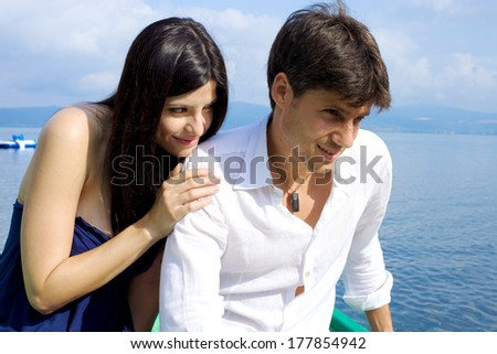 Couple in vacation in Italy after fight get reunited on lake - stock photo