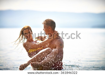 Couple in water - stock photo