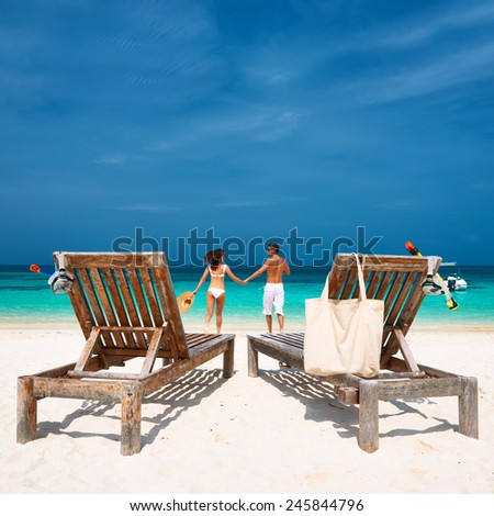 Couple in white running on a tropical beach at Maldives - stock photo