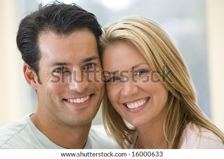 Couple indoors smiling - stock photo