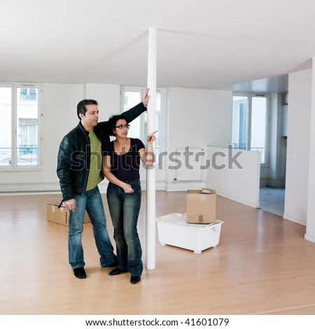 empty apartment inside. couple inside an empty loft apartment moving in Pictures Inside Empty Loft Apartment Couple Stock Photo 41606416