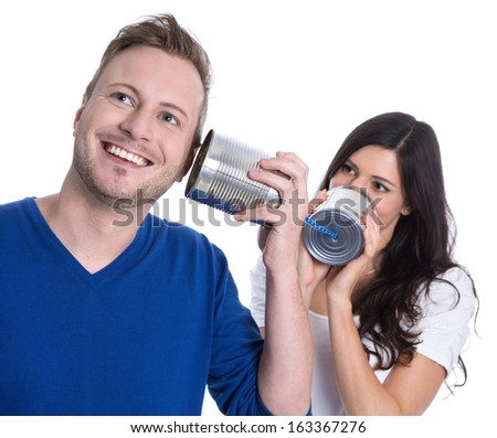 Couple isolated is talking together - communication concept with telephone. - stock photo