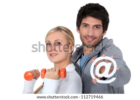 Couple joined the gym via the internet - stock photo