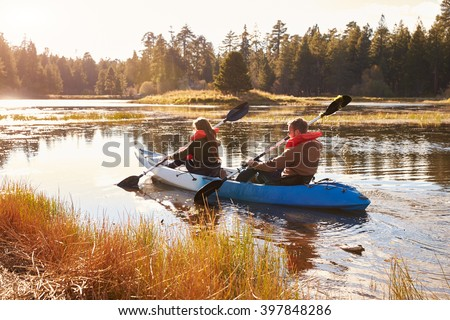 Couple kayaking on lake, back view, Big Bear, California - stock photo