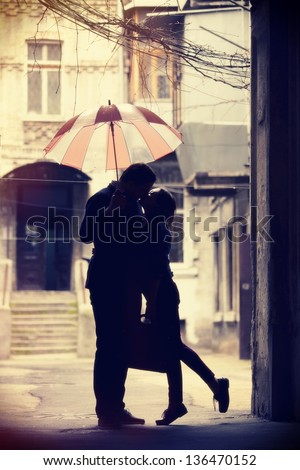 Couple kissing at patio - stock photo