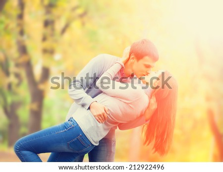 couple kissing outdoor in the park - stock photo