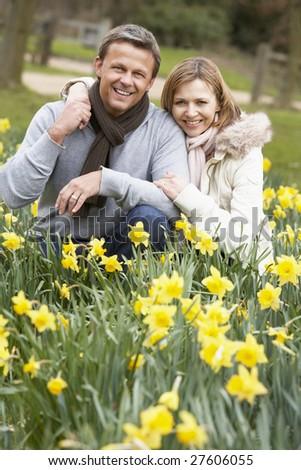 Couple Kneeling In Daffodils - stock photo