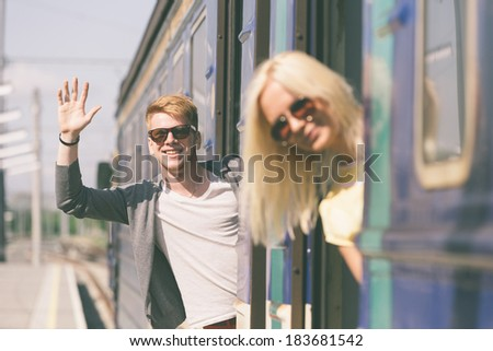 Couple Leaving for Vacation with Train - stock photo