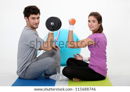 Couple lifting weights - stock photo