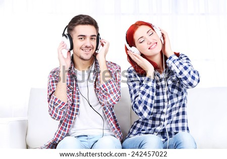 Couple listen to music at home