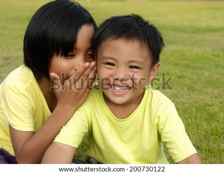 Couple little kid in the green rice fields