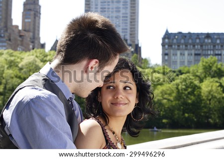 Couple look at each other lovingly. - stock photo