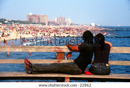 Couple looking at Coney Island. - stock photo