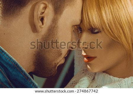 Couple looking at each others with passion outdoors - stock photo
