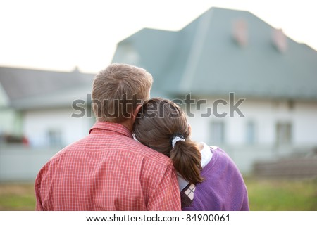 couple looking on house