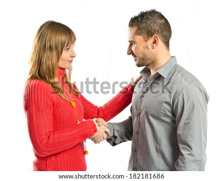 Couple making a deal over isolated white background  - stock photo