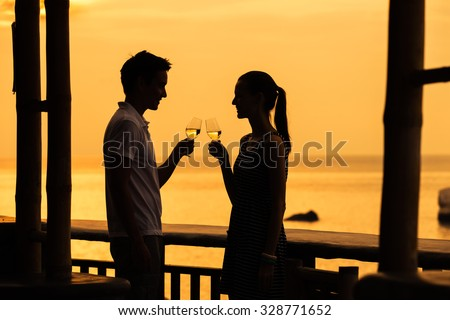 Couple making a toast next to beautiful setting. - stock photo