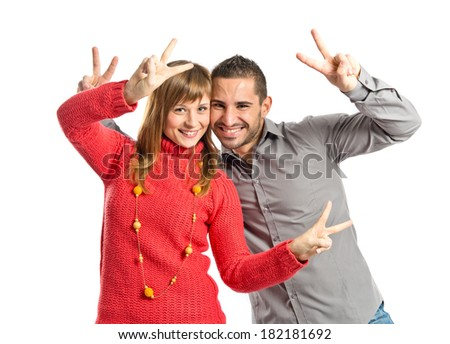 Couple making Ok sign over white background
