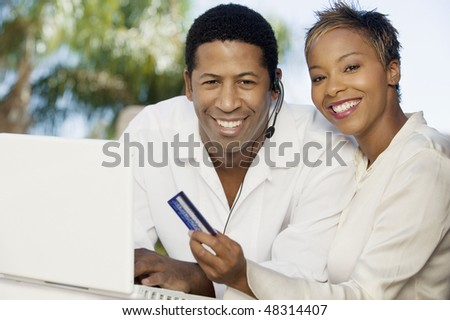 Couple Making Online Purchase - stock photo