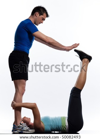 couple,man and woman doing abdominals workout posture on isolated white background - stock photo