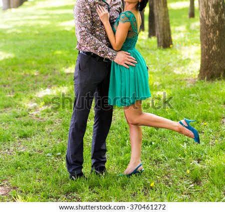Couple Man and Woman Feet in Love Romantic  Outdoor Lifestyle with nature on background Fashion trendy style - stock photo