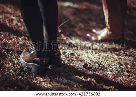 Couple Man and Woman Feet in Romantic Outdoor Lifestyle with nature on background Fashion trendy style