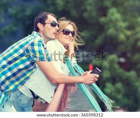 Couple man and woman walking on a city street. Journey. Observation deck. Traveling on vacation. Man in focus, woman is blurred. - stock photo
