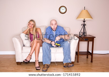Couple: Man Won't Stop Playing Video Games - stock photo