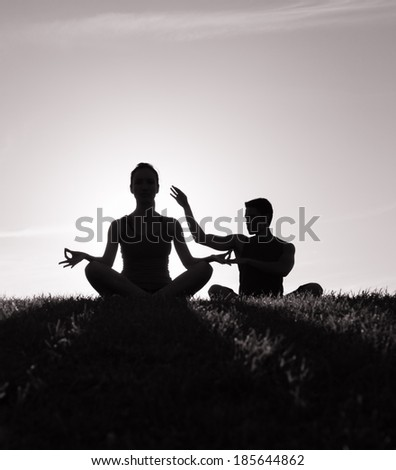 Couple meditating. - stock photo