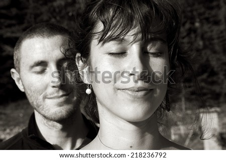 Couple meditating - stock photo