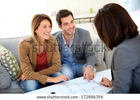 Couple meeting architect for house construction - stock photo
