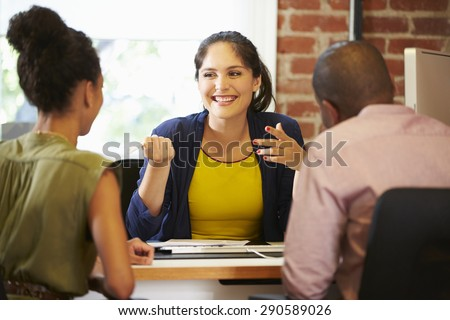 Couple Meeting With Financial Advisor In Office - stock photo