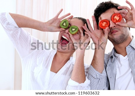 Couple messing around with fruit - stock photo