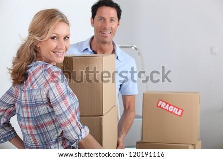 Couple moving boxes - stock photo