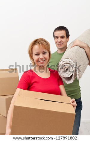 Couple moving into a new home - carrying stuff, closeup