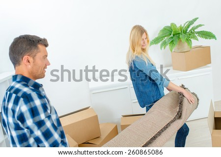 Couple moving into their new home - stock photo