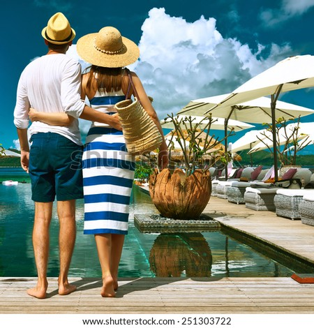 Couple near poolside jetty at Seychelles - stock photo