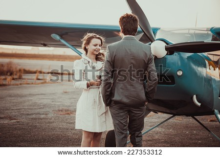 couple near the airplane - stock photo