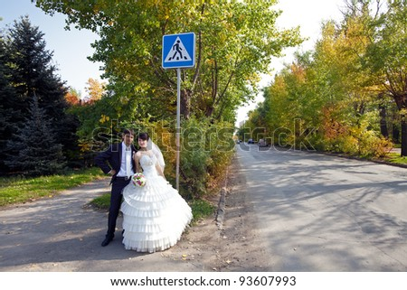 couple near the traffic sign crosswalk
