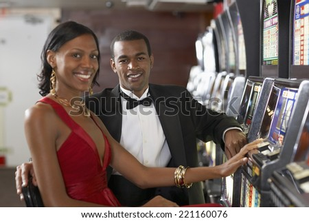 Couple next to slot machines - stock photo