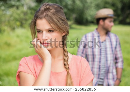 Couple not talking after argument on a sunny day - stock photo