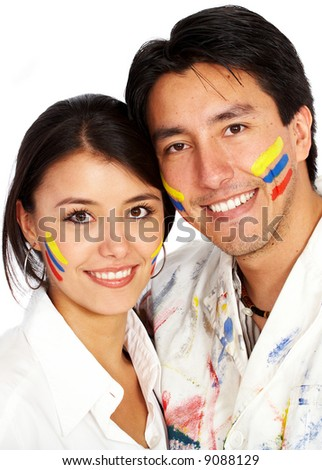 couple of artists with the primary colours painted on their faces - isolated over a white background - stock photo